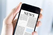 12449108-A-man-holding-mobile-smart-phone-with-news-article-on-screen-Closeup-shot--Stock-Photo